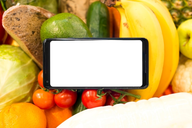 Closeup of smartphone on fruits and vegetables