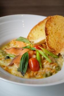 Closeup smoke salmon pasta with garlic bread