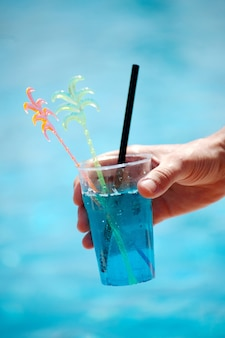 Closeup of a soft cocktail on the background of a pond