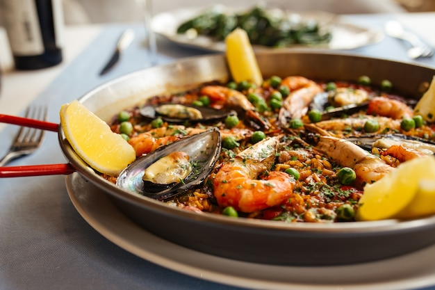 Closeup on spanish national rice dish paella with seafood in a pan