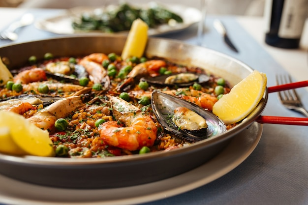 Closeup on spanish seafood paella pan with mussels and shrimp
