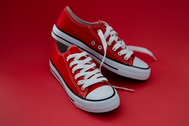 Closeup of sports children sneakers on red background