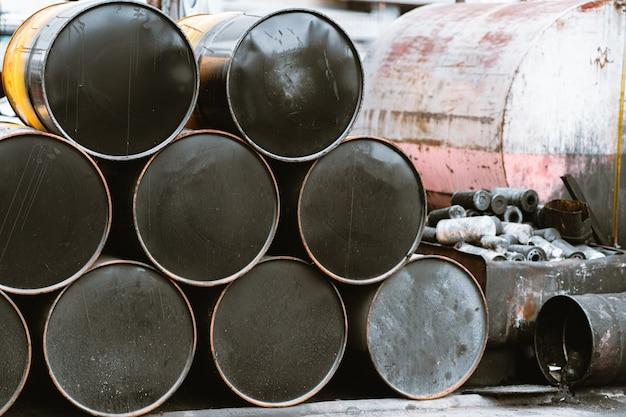 Closeup of stack barrels of black tank oil