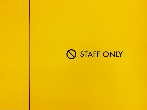 Closeup of staff only sign on a door