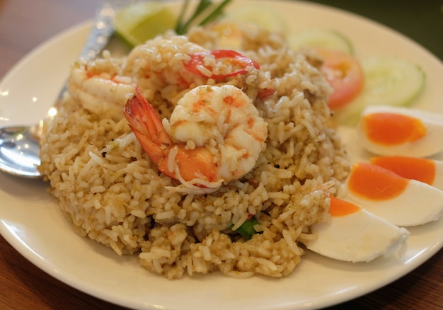 Closeup stir fried rice with spicy shrimp and salt egg