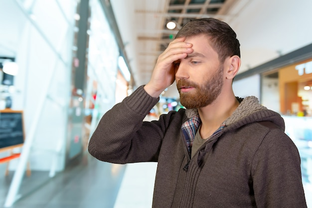 Closeup stressed young man