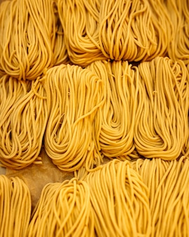 Closeup on strops of dry egg noodle nests