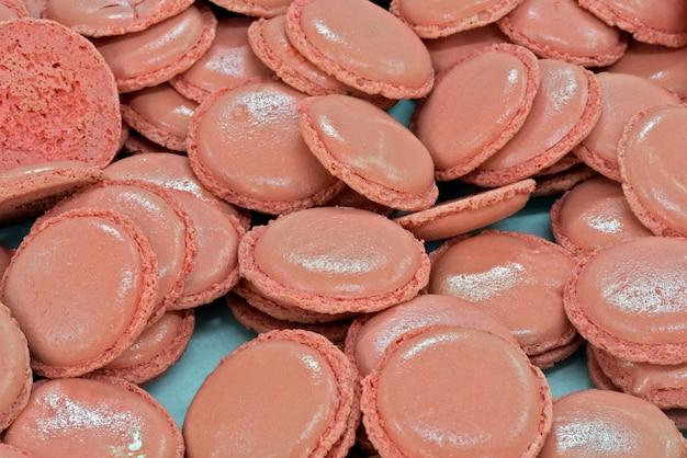 Closeup of stuffing pink macaron
