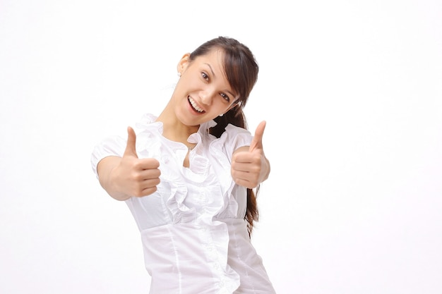 Closeup.successful young woman showing thumbs up. the concept of success.