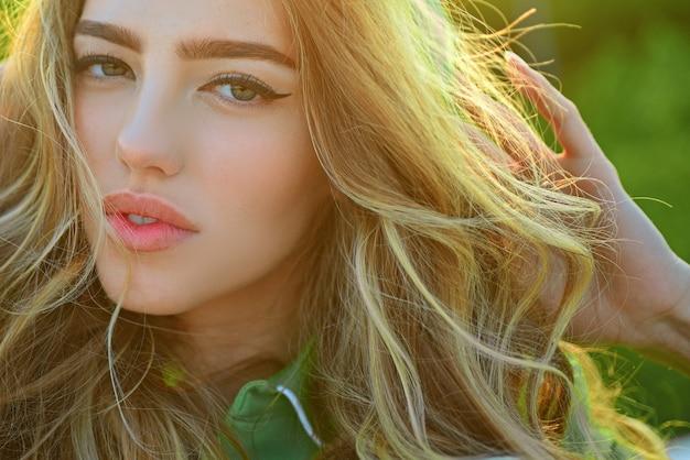 Closeup sunny portrait girl outdoor. natural makeup. seasonal fashion woman. beauty and care.