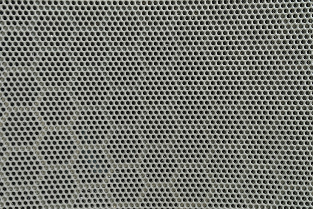 Closeup surface of black metal loudspeaker at the door of car textured background