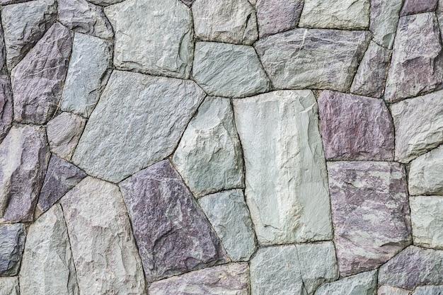 石レンガの壁のテクスチャ背景でクローズアップ表面レンガパターン