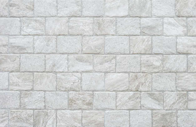 Closeup surface brick pattern at gray stone brick wall texture background