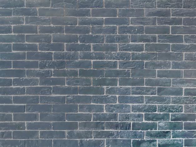Closeup surface brick pattern at old black stone brick wall textured