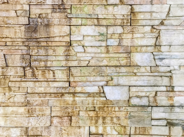 Closeup surface brick pattern at old and dirty wet stone brick wall textured background