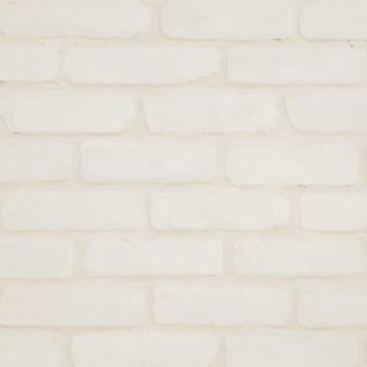 Closeup surface brick wall pattern at cream color brick wallpaper wall textured background