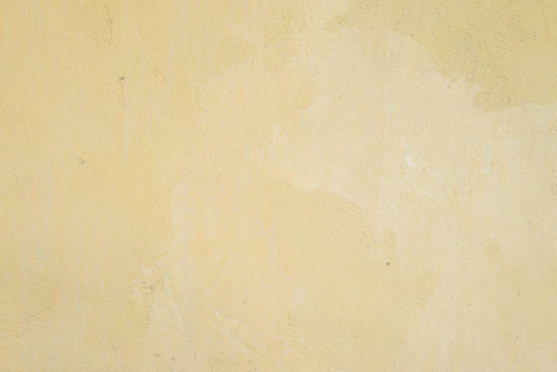 Closeup surface dirty yellow painted concrete wall textured
