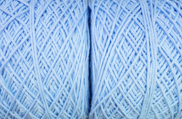 Closeup surface of fabric pattern at pile of blue yarn texture background
