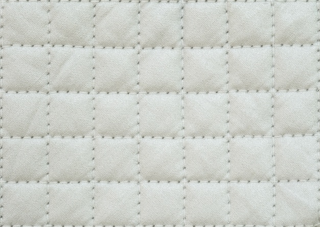Closeup surface fabric pattern at white fabric oven glove for cooking