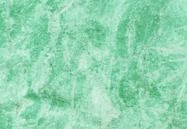 Closeup surface marble pattern at green marble stone wall textured background