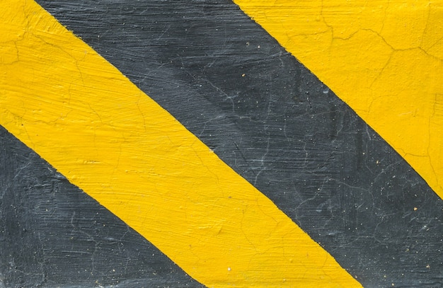 Closeup surface of old yellow and black painted cement floor texture
