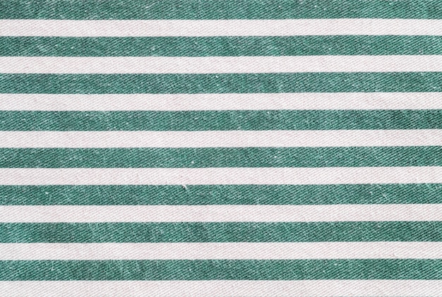 Closeup surface of white and green fabric bag textured background