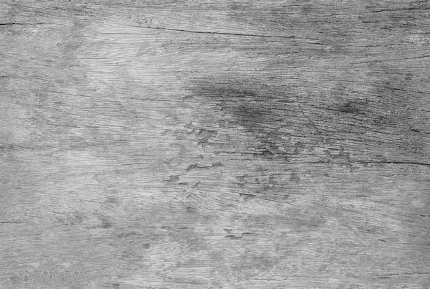 黒と白のトーンの古いと亀裂の木のテーブルテクスチャ背景でクローズアップ表面木目模様