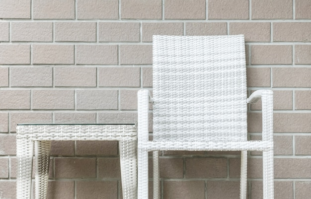 Closeup table and chair on brick wall texture background