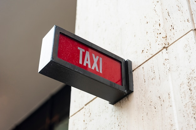 Closeup taxi sign outside building