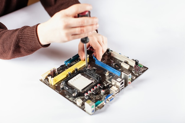 Closeup on tester checking motherboard