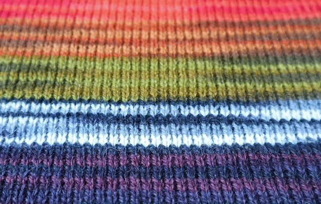 Closeup the texture of colorful striped alpaca knitted wool fabric in horizontal patterns