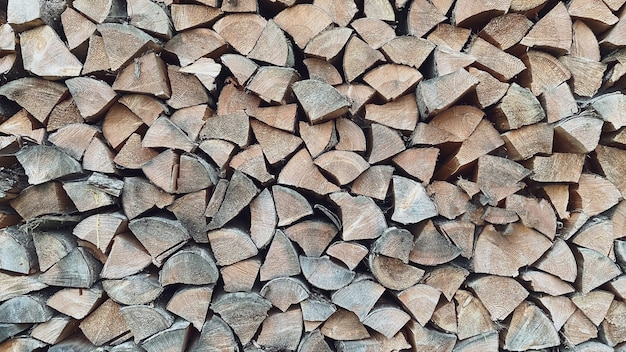 Closeup texture of pine logs prepared and folded neatly