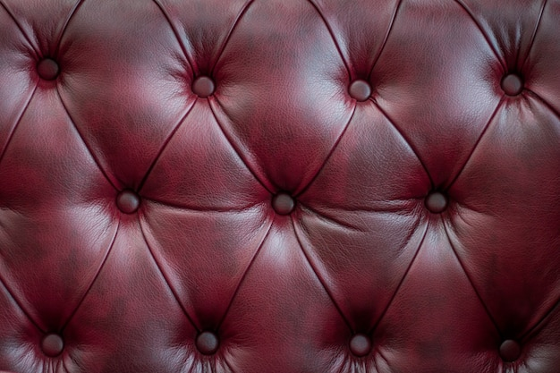 Closeup texture of vintage red leather sofa