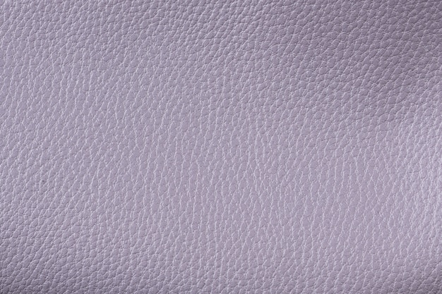 Closeup textured lilac leather background, big grain