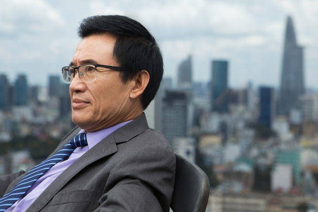 Closeup of thoughtful senior businessman