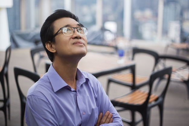 Closeup of thoughtful senior man in cafe