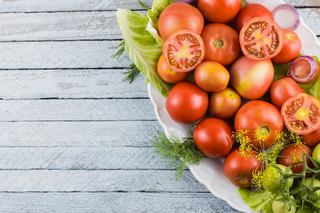 Closeup tomatoes plate with copy space