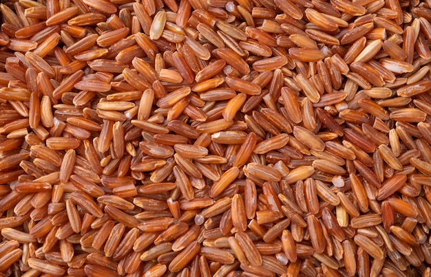 Closeup, top view of whole grain red rice. food backdrop.