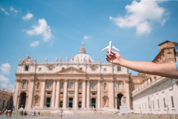 Closeup toy airplane on st. peter's basilica church in vatican city.