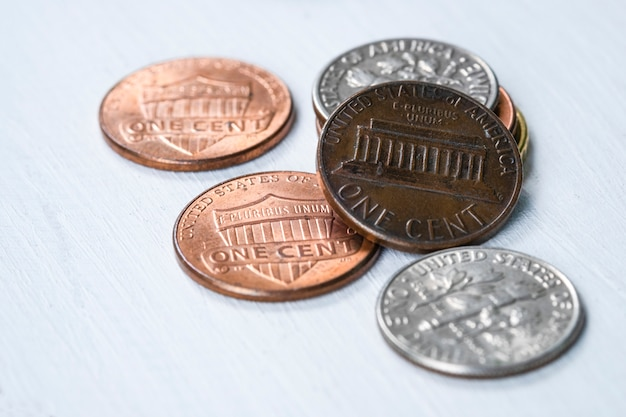 Closeup usa coins on wooden table. saving and investment concept.