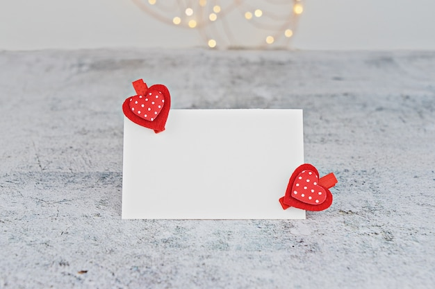 Closeup valentine card with red hearts on gray background
