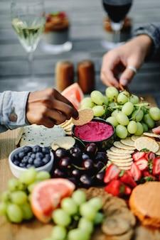 Closeup of a vegan cheese and fruit platter