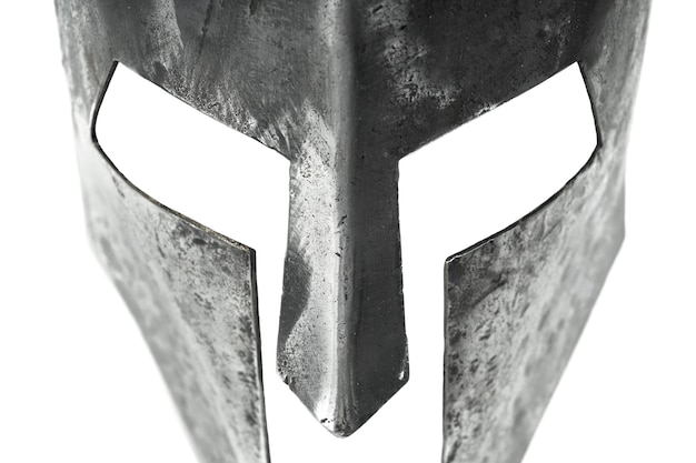 Closeup view of ancient iron spartan helmet isolated