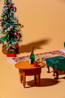 Closeup view on christmas tree and drinks on a table in eve night