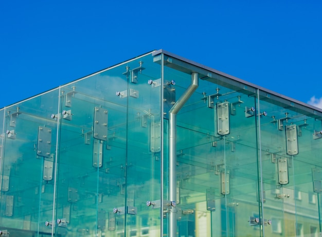 Closeup view on glass wall corner of a building