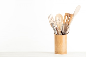 Closeup view of sieve, whisk and kitchen utensils isolated on white background