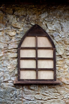 Closeup view of an old medieval wooden window.