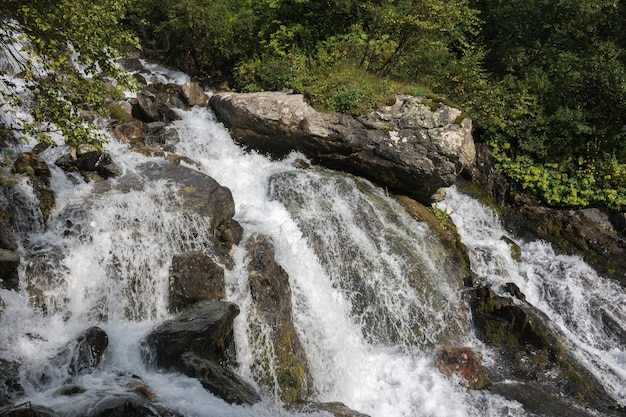 Closeup view waterfall scene in mountains, national park of dombay, caucasus, russia. summer landscape, sunshine weather and sunny day