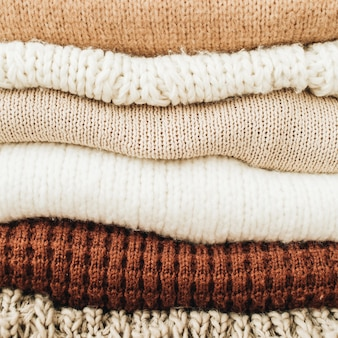 Closeup of warm winter sweaters and pullovers.