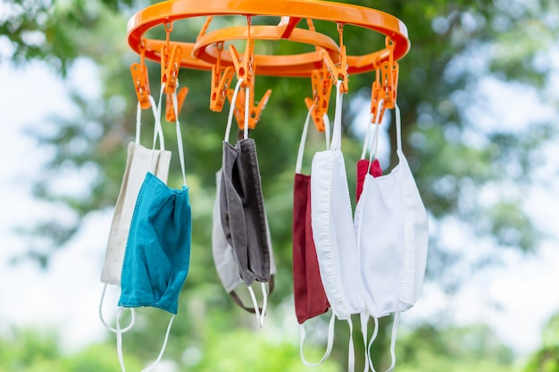 Closeup washed fabric face mask hanging in the air outdoor